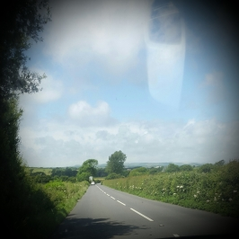The road ahead - blue skies and fluffy white clouds